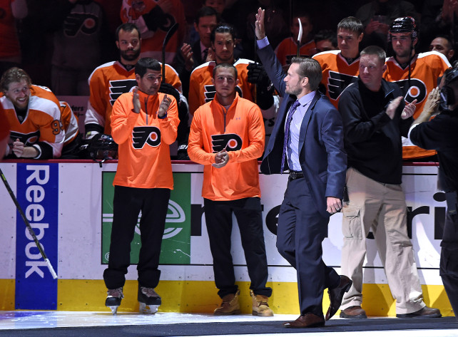 Oct 14, 2015; Philadelphia, PA, USA; Philadelphia Flyers and Chicago Blackhawks former defenseman Kimmo Timonen waves to the crowd as he was honored before the start of the game at Wells Fargo Center. Mandatory Credit: Eric Hartline-USA TODAY Sports